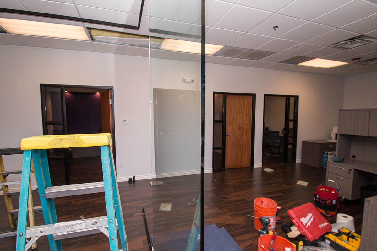 Marsys law commercial heavy glass wall installation a cutting a cutting edge glass mirror 12 heavy glass wall installation amipublicfo Choice Image